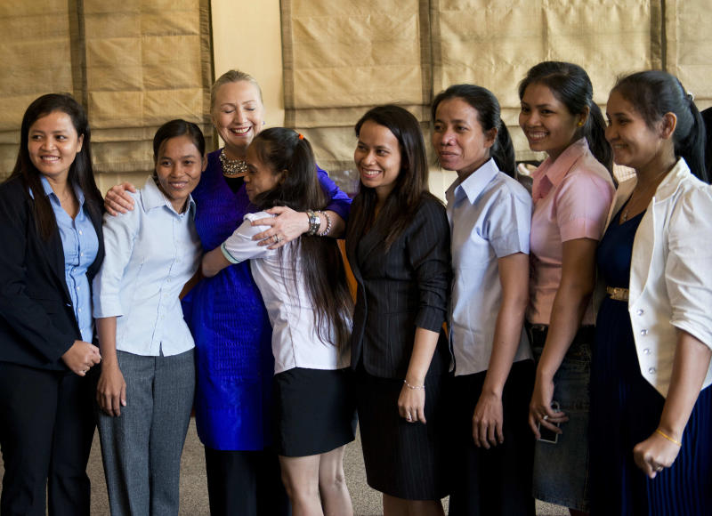 U.S. Secretary of State Hillary Rodham Clinton, third from left, poses for a group photo after a roundtable discussion with Cambodian working women at the Grand Hotel D'Angkor Friday, July 13, 2012 in Siem Reap, Cambodia. Clinton is in Cambodia to attend ASEAN regional forum and meet with other ministers and leaders to strengthen economic and strategic relationships between the Asian and the US. (AP Photo/Brendan Smialowski, Pool)