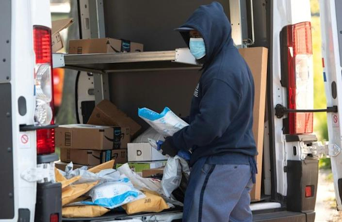 The coronavirus crisis has put an extra strain on the US Postal Service, which is already under a mountain of debt (AFP Photo/SAUL LOEB)
