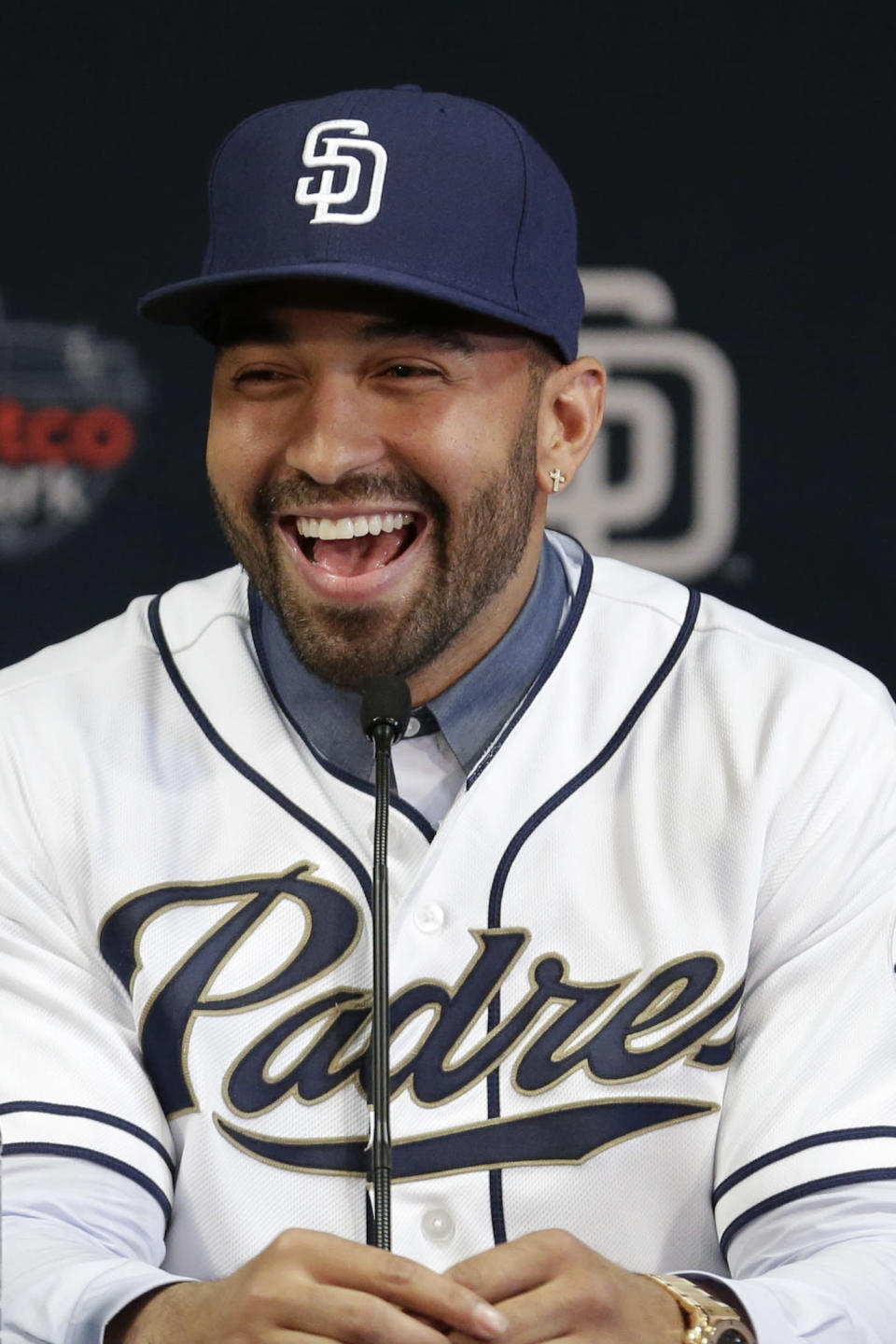 San Diego Padres outfielder Matt Kemp laughs during a news conference introducing him as part of the baseball club Friday, Dec. 19, 2014, in San Diego. The Padres deal for the former the Los Angeles Dodger was the first of three big deals by new Padres general manager A.J. Preller, who also has added outfielder Wil Myers, the 2013 AL Rookie of the Year, from Tampa Bay and All-Star catcher Derek Norris from Oakland. (AP Photo/Gregory Bull)
