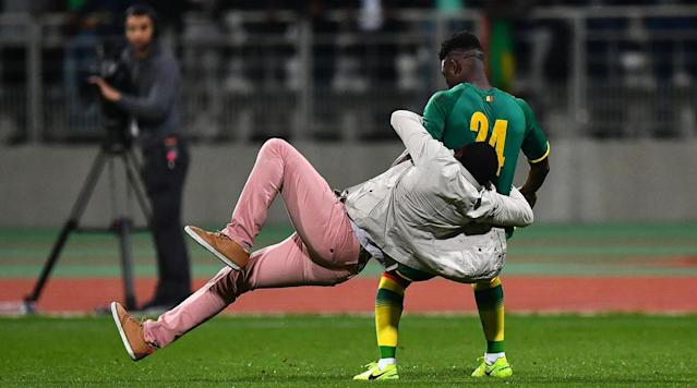 Ivory Coast and Senegal had their Monday friendly called off in the 88th minute after multiple fans ran onto the field at Charlety Stadium in Paris.