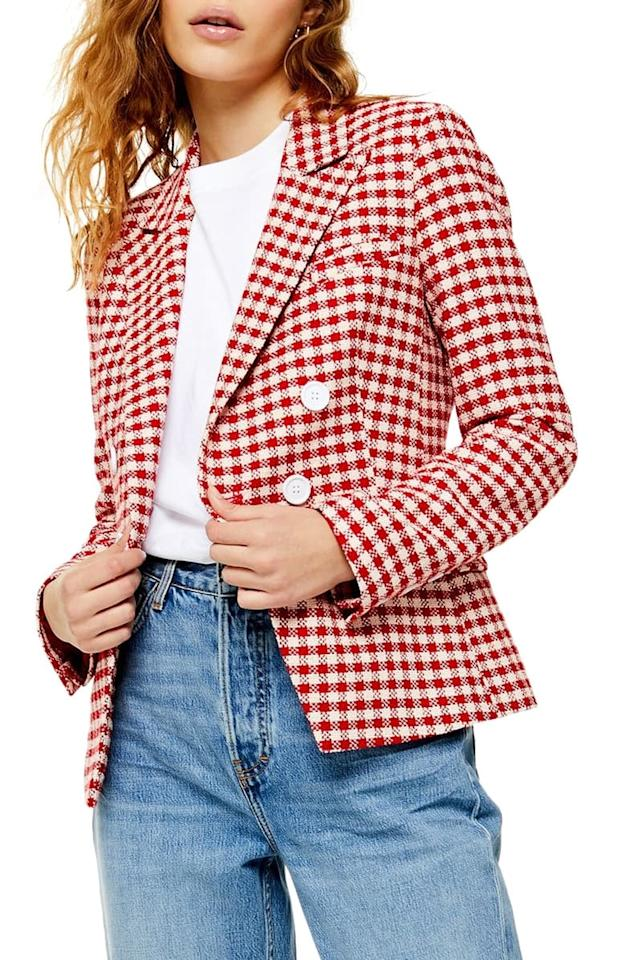 """<p>Wear this <a href=""""https://www.popsugar.com/buy/Topshop-Check-Double-Breasted-Blazer-484167?p_name=Topshop%20Check%20Double-Breasted%20Blazer&retailer=shop.nordstrom.com&pid=484167&price=110&evar1=fab%3Aus&evar9=46542070&evar98=https%3A%2F%2Fwww.popsugar.com%2Ffashion%2Fphoto-gallery%2F46542070%2Fimage%2F46542079%2FTopshop-Check-Double-Breasted-Blazer&list1=shopping%2Cfall%20fashion%2Cblazers%2Cfall&prop13=mobile&pdata=1"""" rel=""""nofollow"""" data-shoppable-link=""""1"""" target=""""_blank"""" class=""""ga-track"""" data-ga-category=""""Related"""" data-ga-label=""""https://shop.nordstrom.com/s/topshop-check-double-breasted-blazer/5302161?origin=category-personalizedsort&amp;breadcrumb=Home%2FWomen%2FClothing%2FCoats%2C%20Jackets%20%26%20Blazers%2FBlazers&amp;color=red%20multi"""" data-ga-action=""""In-Line Links"""">Topshop Check Double-Breasted Blazer</a> ($110) with your favorite jeans.</p>"""