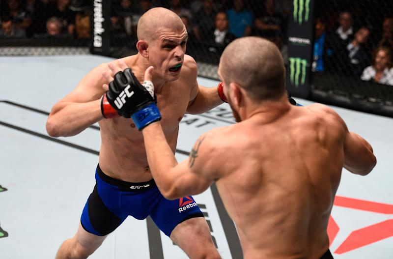 VANCOUVER, BC - AUGUST 27: (L-R) Joe Lauzon of the United States punches Jim Miller of the United States in their lightweight bout during the UFC Fight Night event at Rogers Arena on August 27, 2016 in Vancouver, British Columbia, Canada. (Photo by Jeff Bottari/Zuffa LLC/Zuffa LLC via Getty Images)