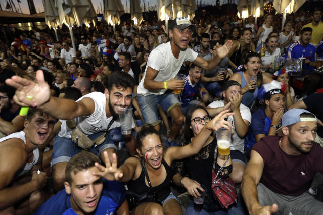 <p>French soccer fans celebrate on the final whistle as they watch a live broadcast of the semifinal match between France and Belgium at the 2018 soccer World Cup, in Marseille, southern France, Tuesday July 10, 2018. France has advanced to the World Cup final for the first time since 2006 with a 1-0 win over Belgium. (AP Photo/Claude Paris) </p>