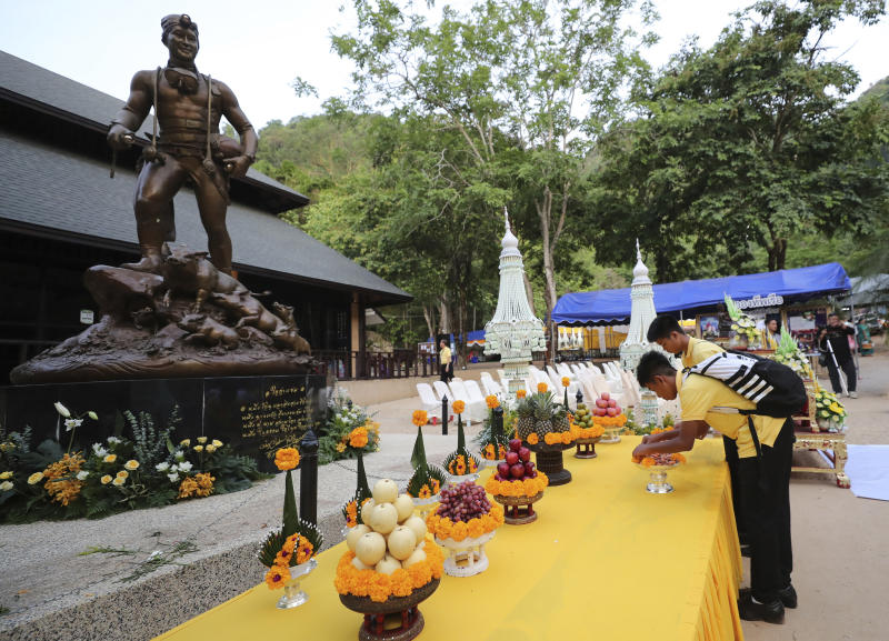 Members of the Wild Boars soccer team who were rescued from a flooded cave, pray in front of the statue of Saman Gunan, the retired Thai SEAL diver who died during the rescue mission, near the Tham Luang cave in Mae Sai, Chiang Rai province, Thailand Monday, June 24, 2019. The 12 boys and their coach attended a Buddhist merit-making ceremony at the Tham Luang to commemorate the one-year anniversary of their ordeal that saw them trapped in a flooded cave for more than two weeks. (AP Photo/Sakchai Lalit)