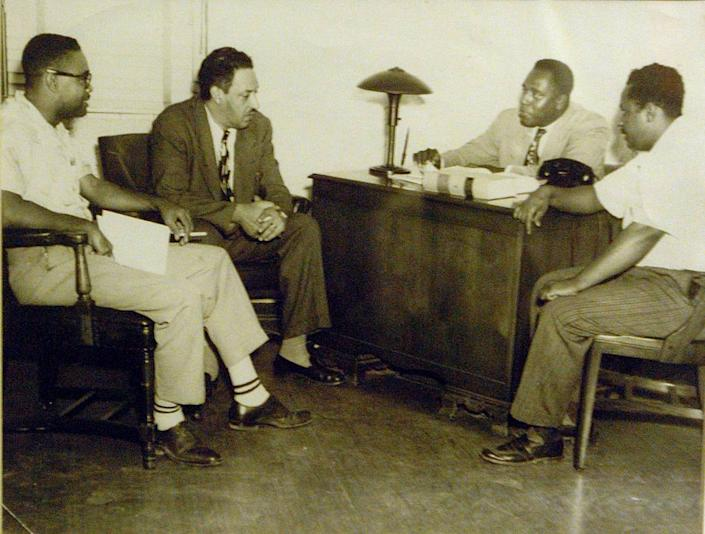 John Johnson was one of the few black attorneys in Miami in the 1940s and became the second black judge to serve in the area. In an old photo are, from left, Garth Reeves, publisher of The Miami Times; Thurgood Marshall, who would go on to become a Supreme Court justice; John Johnson; and G.E. Graves discussing the desegregation of the Miami Springs golf course in 1949.