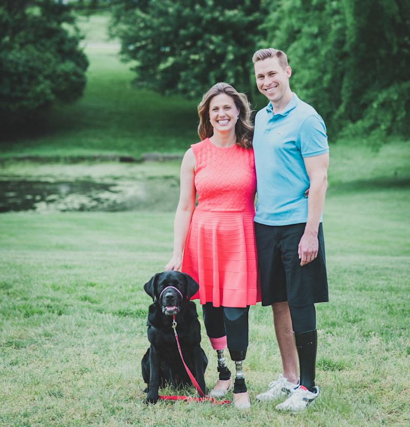 Jessica Kensky and Patrick Downes, who lost three legs between them in the blasts,pose with their support dog, Rescue.