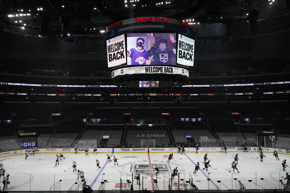 A sign welcomes back fans amid the COVID-19 pandemic as the Los Angeles Kings and Anaheim Ducks warm up before an NHL hockey game Tuesday, April 20, 2021, in Los Angeles. (AP Photo/Marcio Jose Sanchez)