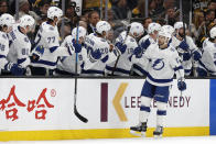 Tampa Bay Lightning's Cedric Paquette is congratulated at the bench after scoring against the Boston Bruins during the second period of an NHL hockey game Saturday, March 7, 2020, in Boston. (AP Photo/Winslow Townson)