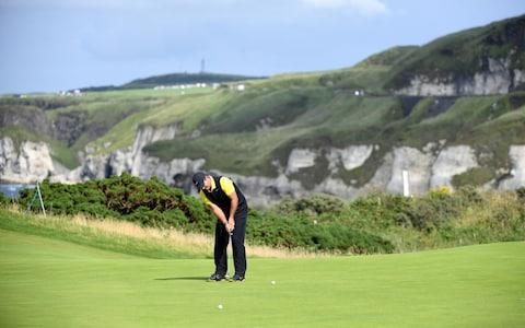Patrick Reed of the US plays a putt on the first day of the British Open Golf Championship - Credit: REX