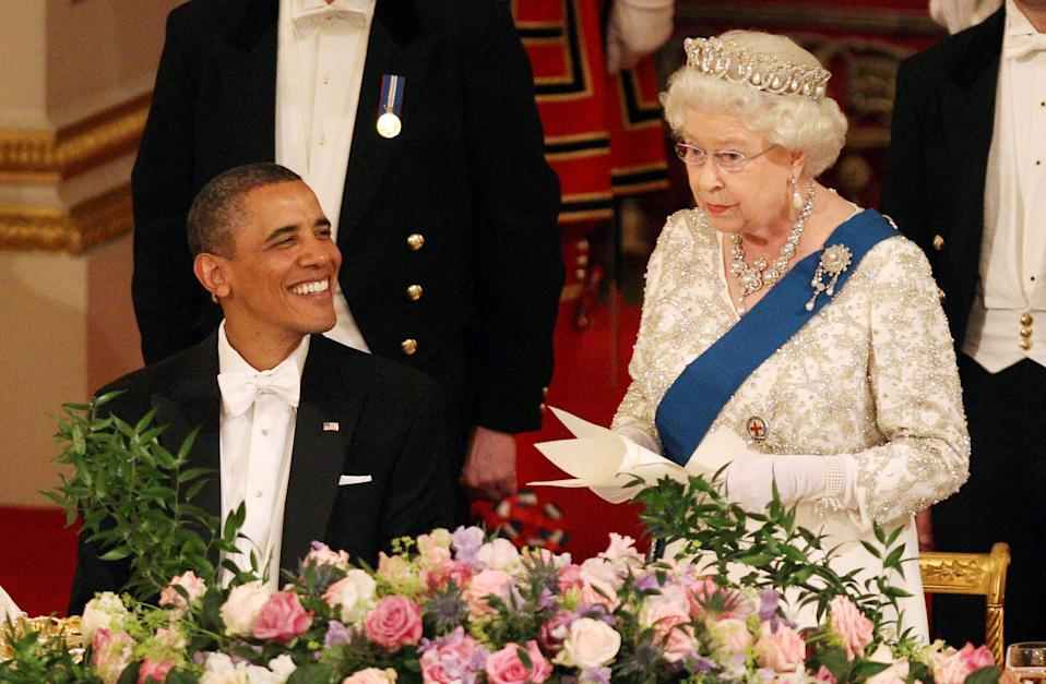 Her Majesty The Queen with American President Barack Obama at the start of the State Banquet at Buckingham Palace during his State Visit. Picture date: Tuesday, May 24, 2011. See PA story. Photo credit should read: Lewis Whyld/PA Wire