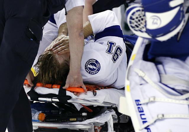 Tampa Bay Lightning center Steven Stamkos is taken off the ice on a stretcher after banging into the goalpost during the second period of an NHL hockey game against the Boston Bruins in Boston Monday, Nov. 11, 2013. (AP Photo/Elise Amendola)