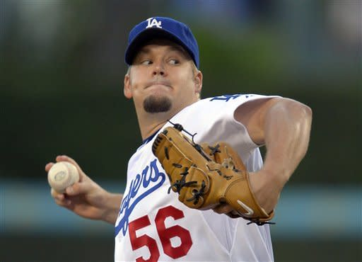 Los Angeles Dodgers starting pitcher Joe Blanton throws to the plate during the first inning of a baseball game against the Colorado Rockies, Saturday, Sept. 29, 2012, in Los Angeles. (AP Photo/Mark J. Terrill)