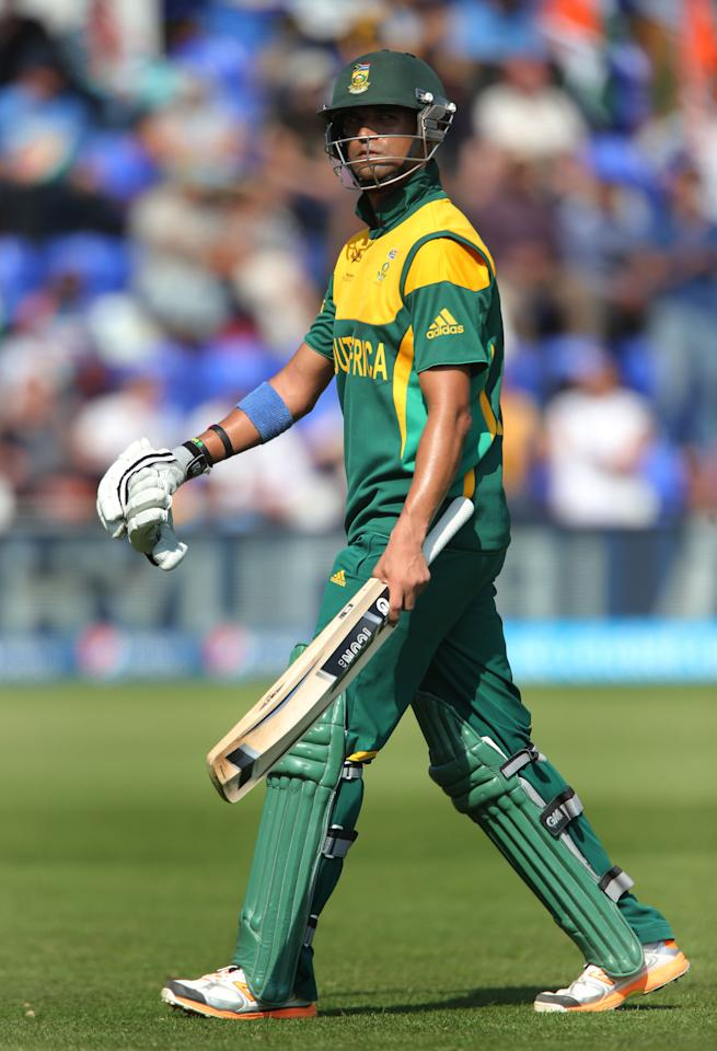 South Africa batsman Robin Peterson shows his dejection after he was run out after building a good score with captain AB De Villiers against India on opening day of the ICC Champions Trophy. The SWALEC Stadium, Cardiff.