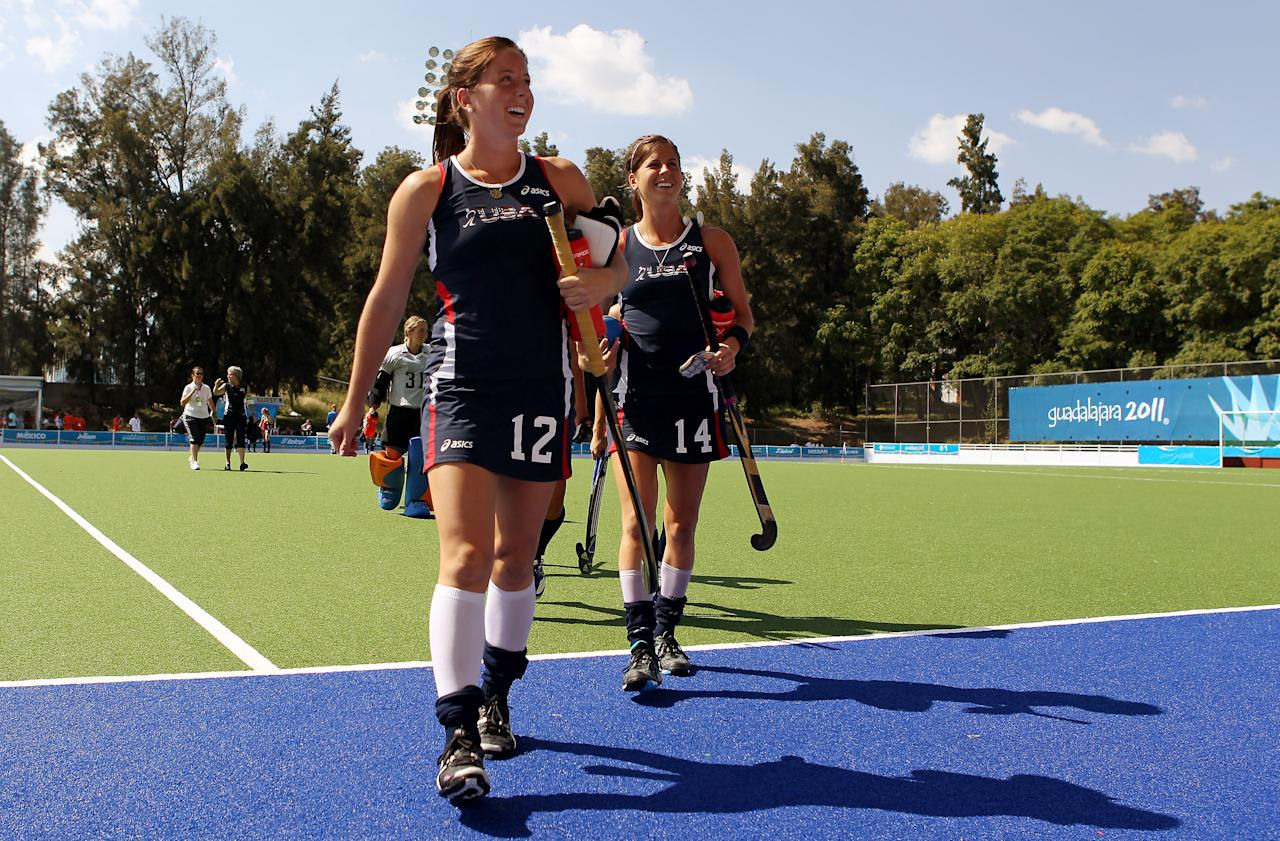 GUADALAJARA, MEXICO - OCTOBER 19:  Julia Reinprecht (L) and Katherine Reinprecht of the USA field hockey team leave the field after their victory over Mexico during the XVI Pan American Games Day Five on October 19, 2011 in Guadalajara, Mexico.  (Photo by Scott Heavey/Getty Images)