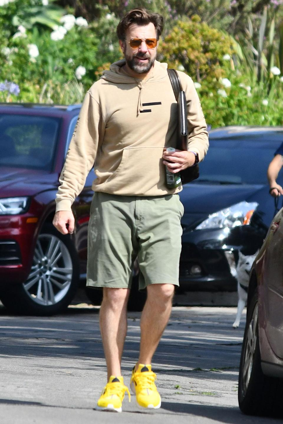 <p>Jason Sudeikis steps in Los Angeles on Friday for an outing with longtime partner Olivia Wilde (not pictured).</p>