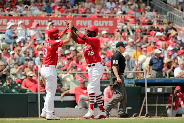 St. Louis Cardinals' Dexter Fowler, right, celebrates with teammate Matt Carpenter, left, after they both scored in the third inning during an exhibition spring training baseball game against the Washington Nationals on Monday, March 11, 2019, in Jupiter, Fla. (AP Photo/Brynn Anderson)