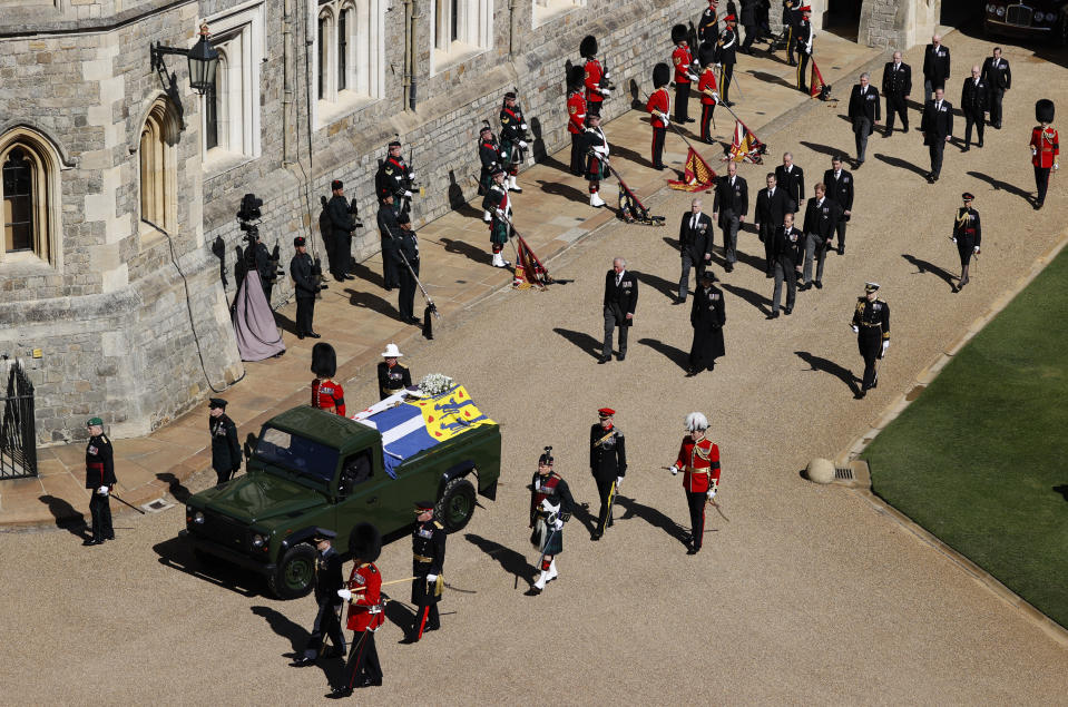 Members of the Royal family, led by Prince Charles, center left, and Princess Anne, center right, follow behind the coffin of Britain's Prince Philip in the Quadrangle at Windsor Castle in Windsor, England, Saturday, April 17, 2021 ahead of the funeral of Britain's Prince Philip. Prince Philip died April 9 at the age of 99 after 73 years of marriage to Britain's Queen Elizabeth II. (Adrian Dennis/Pool via AP)