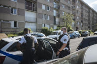 Police officers patrol in the Paris suburb of Sarcelles, Tuesday, June, 15, 2021. On their patrols through the northern Paris suburbs of Sarcelles, Villiers-le-Bel and their surroundings, officers make a point of regularly driving past – and sometimes stopping – at street corners and neighborhoods that they have identified as hotspots for drug dealing and other crimes. Officers say they want to make clear to inhabitants that there are no 'no-go zones' for the law. (AP Photo/Lewis Joly)