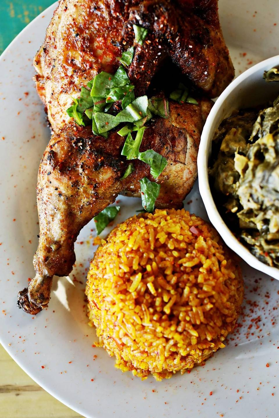 Zweli's in Durham serves a half chicken with a side of collard greens cooked with peanut butter and Jollof rice.