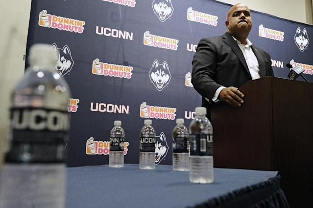 Connecticut Athletic Director Warde Manuel speaks at an NCAA college football news conference after the dismissal of Connecticut football coach Paul Pasqualoni, Monday, Sept. 30, 2013, in Storrs, Conn. Offensive coordinator T.J. Weist will take over as interim head coach. (AP Photo/Jessica Hill)