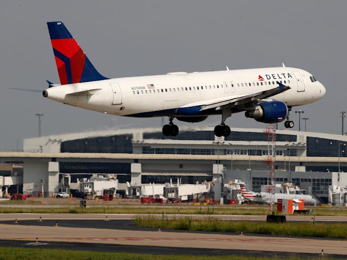 FILE - In this June 24, 2019, file photo a Delta Air Lines aircraft makes its approach at Dallas-Fort Worth International Airport in Grapevine, Texas. Delta Air Lines reports earns Tuesday, Oct. 8. (AP Photo/Tony Gutierrez, FIle)