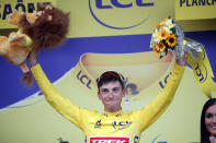 Italy's Giulio Ciccone celebrates with the overall leader's yellow jersey on the podium, at the end of the sixth stage of the Tour de France cycling race over 160 kilometers (100 miles) with start in Mulhouse and finish in La Planche des Belles Filles, France, Thursday, July 11, 2019. (AP Photo/Christophe Ena)