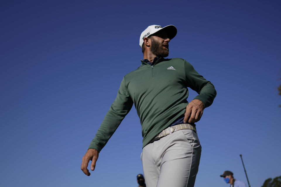 Dustin Johnson walks to the range during practice for the Masters golf tournament on Monday, April 5, 2021, in Augusta, Ga. (AP Photo/David J. Phillip)
