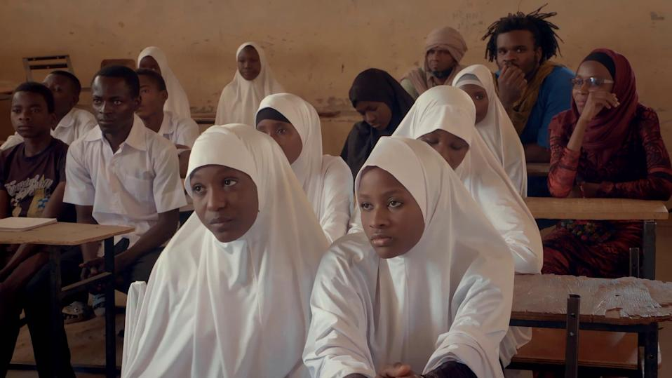 School children listen to the story of Voulet's campaign (BBC / Inside Out Films/ LemKino Pix)