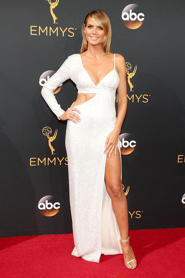 <p>Emmy winner and <i>Project Runway</i> hostess with the mostest Heidi Klum put her rockin' bod on display on the Emmys red carpet in a revealing silver Michael Kors creation that showcased her award-worthy abs. In addition to her peekaboo frock, the 43-year-old mom of four sported sleek locks, a statement cocktail ring, and matching strappy sandals. (Photo by Getty Images)</p>