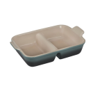 """<p><strong>Le Creuset</strong></p><p>lecreuset.com</p><p><a href=""""https://go.redirectingat.com?id=74968X1596630&url=https%3A%2F%2Fwww.lecreuset.com%2Fheritage-rectangular-divided-baking-dish-ocean-factory-to-table-sale%2FPG0700-26D44.html&sref=https%3A%2F%2Fwww.cosmopolitan.com%2Ffood-cocktails%2Fg36067224%2Fle-creuset-factory-to-table-sale%2F"""" rel=""""nofollow noopener"""" target=""""_blank"""" data-ylk=""""slk:Shop Now"""" class=""""link rapid-noclick-resp"""">Shop Now</a></p><p><strong><del>$85</del> $42.50 (50% off)</strong></p><p>Thanks to this innovative pick, you can cook two things at once! The divided design makes this perfect for cooking bacon-packed macaroni and cheese, plus a vegetarian option.</p>"""