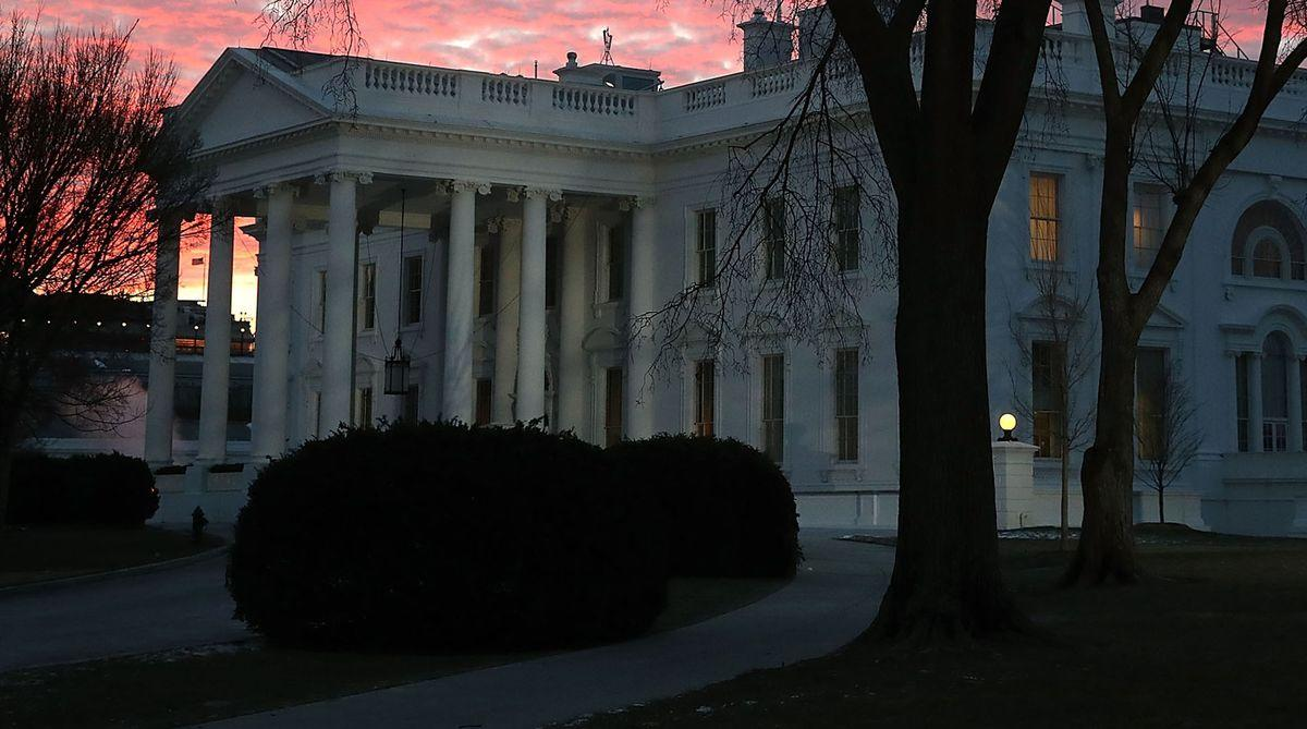 WASHINGTON, DC - JANUARY 08: The early morning sun lights up the sky over the White House on January 8, 2018 in Washington, DC. Later today President Donald Trump will travel to Atlanta, Georgia to attend the NCAA National Championship football game with Alabama Crimson Tide playing the Georgia Tech Yellow Jackets. (Photo by Mark Wilson/Getty Images) Photographer: Mark Wilson/Getty Images North America