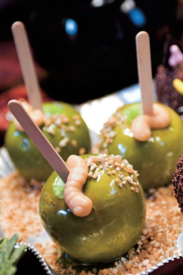 """<p>Get ready to sink your teeth into these candy apples decorated with gummy worms and pralines. </p><p><a href=""""https://www.womansday.com/food-recipes/food-drinks/a28858378/candy-apples-with-gummy-worms-recipe/"""" rel=""""nofollow noopener"""" target=""""_blank"""" data-ylk=""""slk:Get the Candy Apples with Gummy Worms recipe."""" class=""""link rapid-noclick-resp""""><strong><em>Get the Candy Apples with Gummy Worms recipe. </em></strong> </a></p>"""