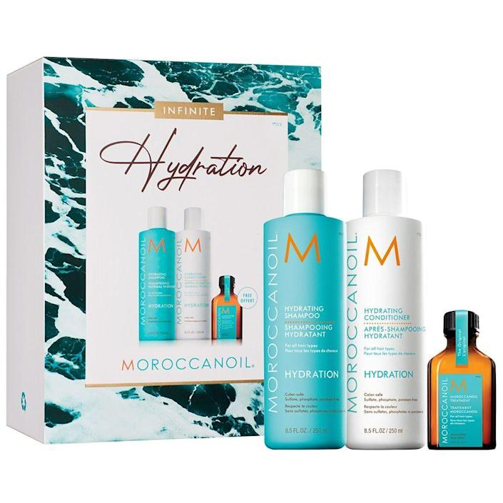 """<p><strong>Moroccanoil</strong></p><p>sephora.com</p><p><strong>$48.00</strong></p><p><a href=""""https://go.redirectingat.com?id=74968X1596630&url=https%3A%2F%2Fwww.sephora.com%2Fproduct%2Fmoroccanoil-infinite-hydration-set-P472172&sref=https%3A%2F%2Fwww.bestproducts.com%2Fbeauty%2Fg256%2Fchristmas-holiday-beauty-gifts%2F"""" rel=""""nofollow noopener"""" target=""""_blank"""" data-ylk=""""slk:Shop Now"""" class=""""link rapid-noclick-resp"""">Shop Now</a></p><p>Give the gift of better hair with this trio set from Moroccanoil. It's a full-sized trifecta of everything you need for smoother, stronger strands. </p><p>The Hydrating Shampoo and Conditioner both have gentle formulas that deeply cleanse and add hydration to thirsty, brittle strands. You can also expect to find naturally-derived ingredients like antioxidant-rich argan oil and hair-quenching red algae in each of them. The results: a mane with manageability, smoothness, and shine.</p><p>To boost shine and banish frizz and flyaways, apply a small amount of the included Treatment Oil to your strands when they're damp <em>and </em>as a finishing touch once your hair is styled.</p>"""
