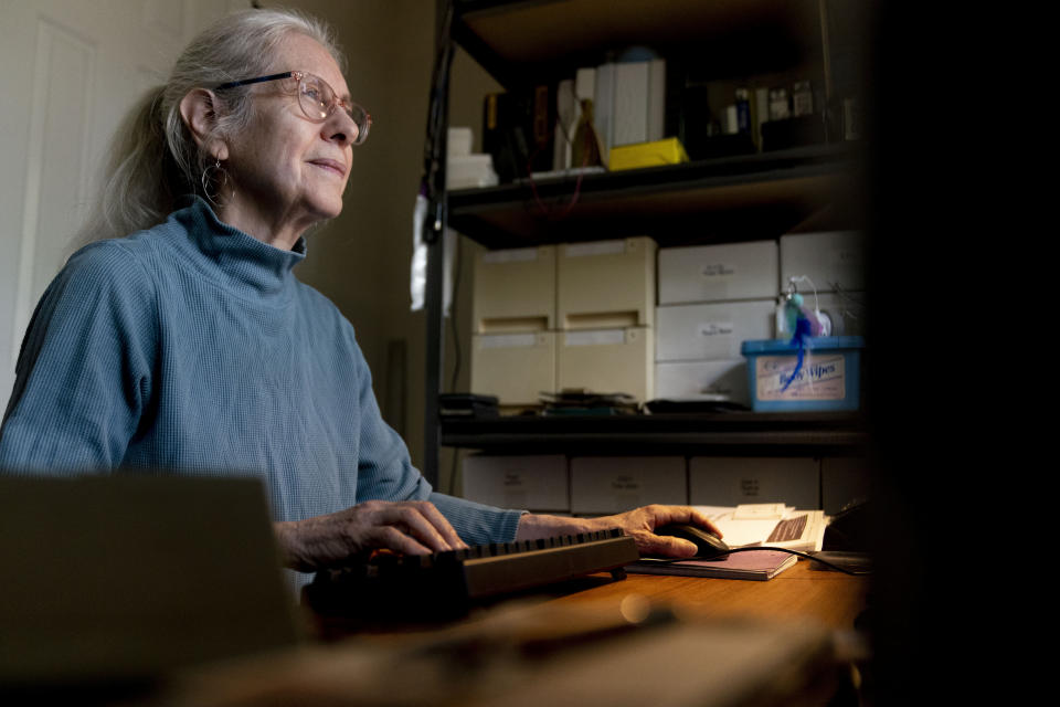 Detta Kissel, a former Treasury Department attorney, poses for a photograph at her home in Arlington, Va., Wednesday, Sept. 8, 2021. Kissel is now a local advocate for expanded broadband service. (AP Photo/Andrew Harnik)