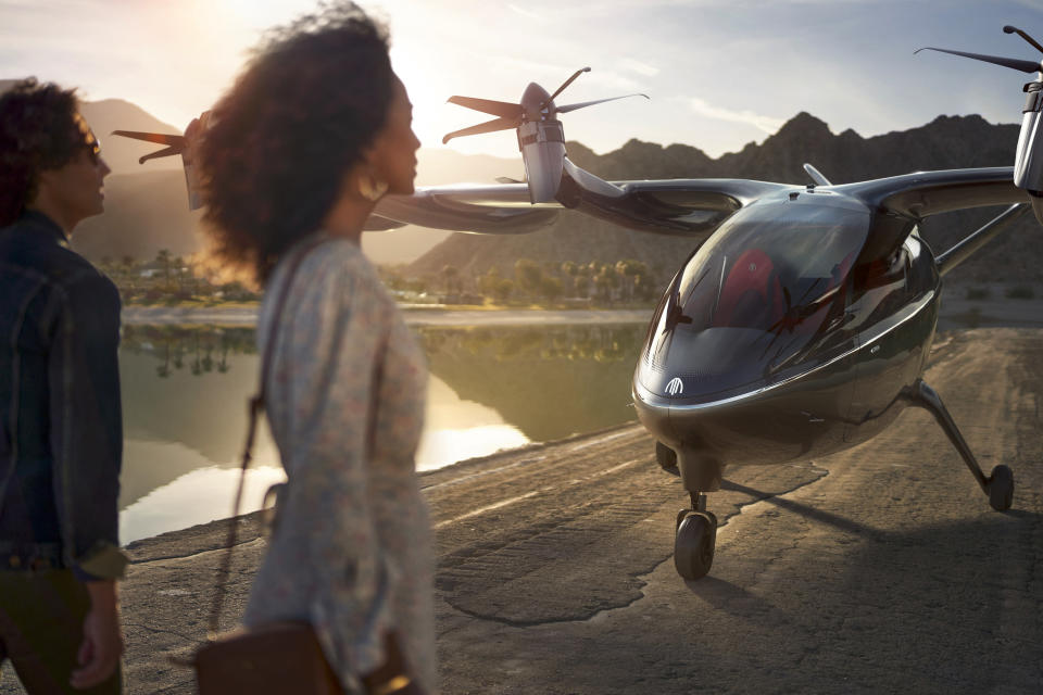This photo provided by Archer shows the company's eVTOL aircraft. On Wednesday, Feb. 10, 2021, United Airlines announced it will buy up to 200 small electric air taxis to help customers in urban areas get to the airport. The airline said it will help electric-aircraft startup Archer develop an aircraft capable of helicopter-style, vertical takeoffs and landings. Archer hopes to deliver its first aircraft in 2024, if it wins certification from the Federal Aviation Administration. (Jeff Ludes/Archer via AP)