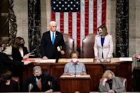 US Vice President Mike Pence, alongside House Speaker Nancy Pelosi, presided over a joint session of Congress that certified Joe Biden's 2020 election victory over President Donald Trump