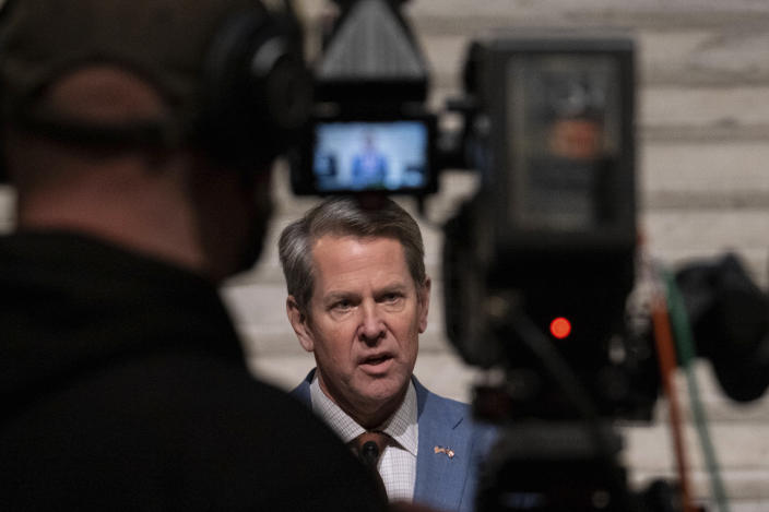 FILE - In this Jan. 6, 2021, file photo, Georgia Gov. Brian Kemp, center, holds a news conference at the Georgia State Capitol in Atlanta, to condemn the riot at the U.S. Capitol. (AP Photo/Ben Gray, File)