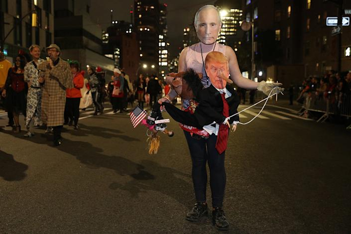 A reveler wearing a political costume featuring Donald Trump and Vladimir Putin marches in the 46th annual Village Halloween Parade in New York City. (Gordon Donovan/Yahoo News)