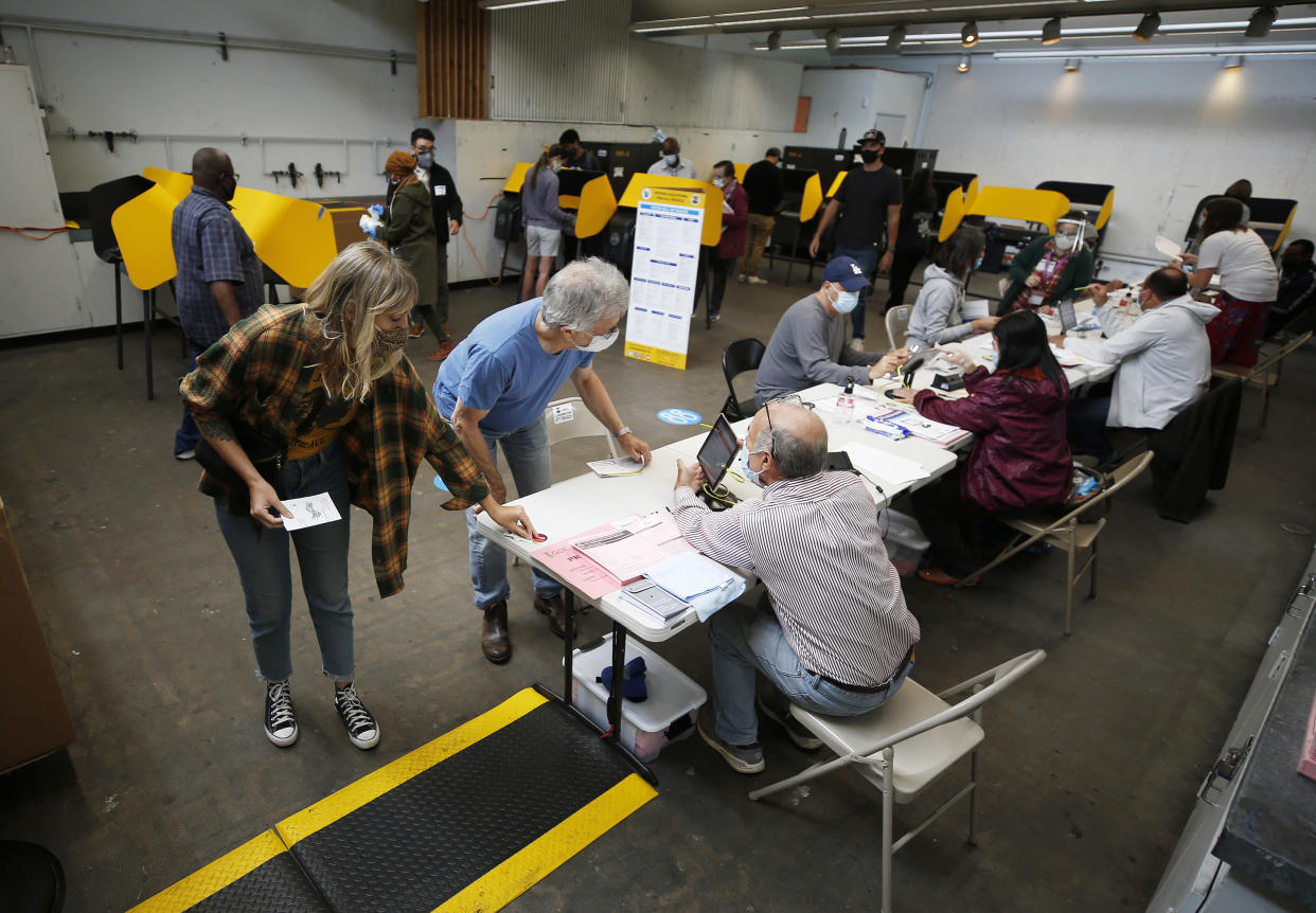 Voters cast their ballots at a vote center at Santa Monica College.