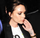 <p>One of Victoria Beckham's first tattoos was her husband's initials 'DB' on her wrist. On her tenth wedding anniversary, Victoria added to her tattoo, getting the words 'Together, forever, eternally,' in Hebrew underneath.<br>[Photo: Getty] </p>