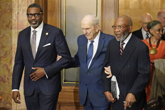 The Rev. Amos C. Brown, right, President Russell M. Nelson of The Church of Jesus Christ of Latter-day Saints, center, and Derrick Johnson, president and CEO of the NAACP, left, attend a news conference Monday, June 14, 2021, in Salt Lake City. Top leaders from the NAACP and The Church of Jesus Christ of Latter-day Saints announced $9.25 million in new educational and humanitarian projects as they seek to build on an alliance formed in 2018. (AP Photo/Rick Bowmer)