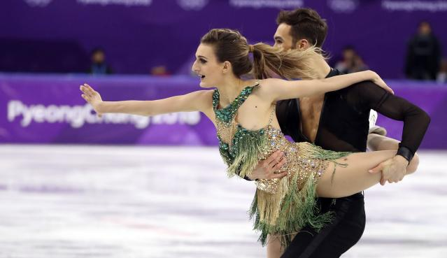 <p>Guillaume Cizeron and Gabriella Papadakis of France perform. REUTERS/Lucy Nicholson </p>