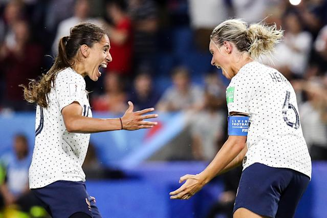 French captain Amandine Henry (6) celebrates her goal to beat Brazil with Amel Majri on Sunday in Le Havre. (Getty)
