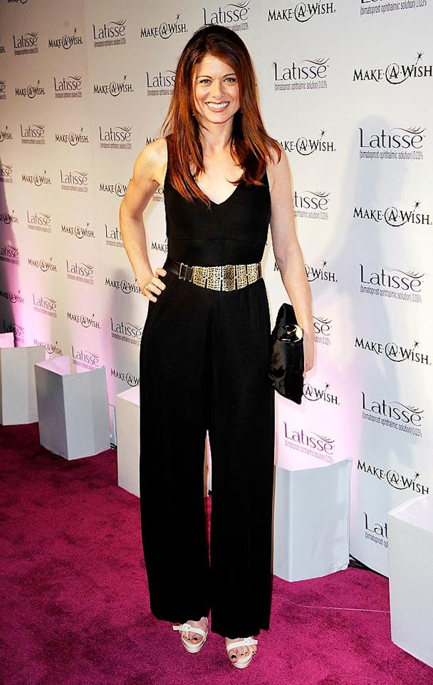 """Debra Messing dared to wear a black jumpsuit to the event. Too bad her big belt is off center in this pic! Kevin Winter/<a href=""""http://www.gettyimages.com/"""" target=""""new"""">GettyImages.com</a> - March 26, 2009"""