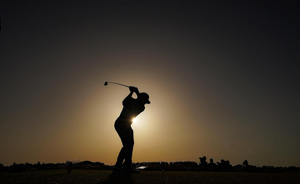 Louis Oosthuizen tees off on the 18th during day three of the 149th Open (PA Wire)