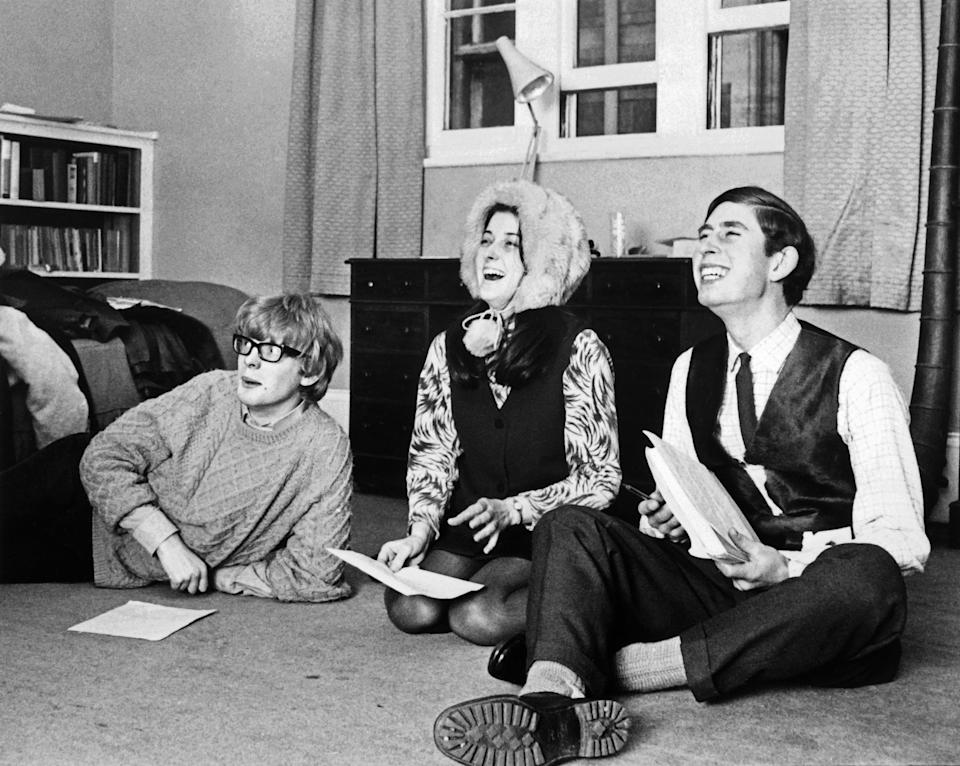 Prince Charles of Wales (R) laughing with other students of his university. He was a big part of acting societies at Cambridge. (AFP via Getty Images)