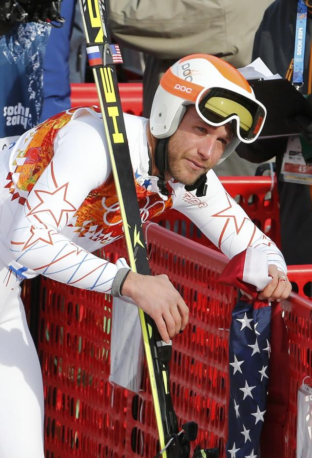Bode Miller of the U.S. cries in the mixed zone after finishing in the men's alpine skiing Super-G competition during the 2014 Sochi Winter Olympics at the Rosa Khutor Alpine Cente February 16, 2014. REUTERS/Leonhard Foeger (RUSSIA - Tags: OLYMPICS SPORT SKIING)