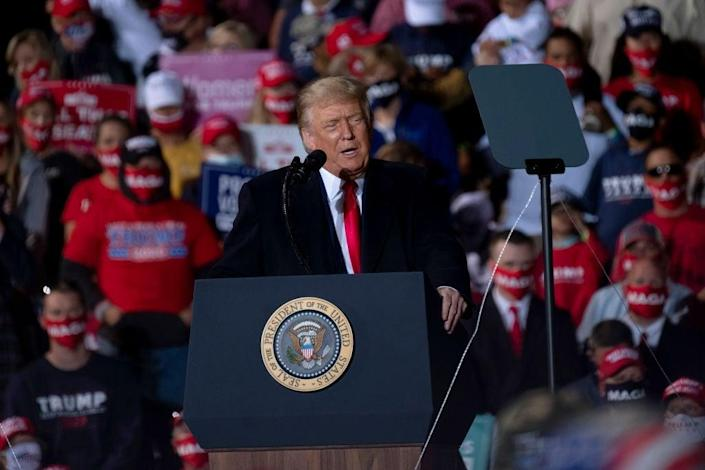 Donald Trump rallied his supporters in Swanton, Ohio, on Monday with a message that Joe Biden would usher in an era of 'communism' in the US. (Getty Images)