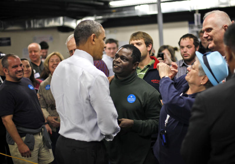 President Barack Obama greets supporters at the office of Teamsters local 633 in Manchester, N.H., during an unscheduled visit to Saturday, Oct. 27, 2012. (AP Photo/Pablo Martinez Monsivais)
