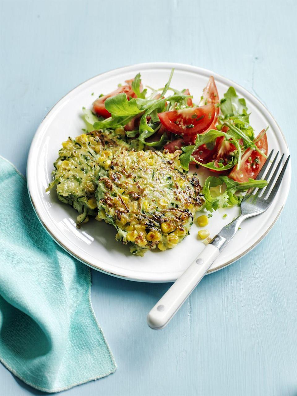 """<p>Fresh veggies are the stars of this meatless main, dressed in extra-virgin olive oil.</p><p><a href=""""https://www.womansday.com/food-recipes/food-drinks/recipes/a55356/corn-and-zucchini-fritters-recipe/"""" rel=""""nofollow noopener"""" target=""""_blank"""" data-ylk=""""slk:Get the Corn and Zucchini Fritters recipe."""" class=""""link rapid-noclick-resp""""><em>Get the Corn and Zucchini Fritters recipe.</em></a> </p>"""